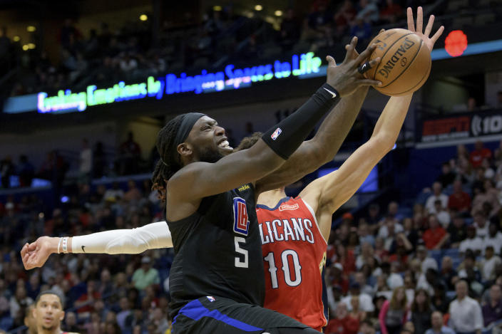Los Angeles Clippers forward Montrezl Harrell (5) is fouled by New Orleans Pelicans center Jaxson Hayes (10) in the first half an NBA basketball game in New Orleans, Saturday, Jan. 18, 2020. (AP Photo/Matthew Hinton)