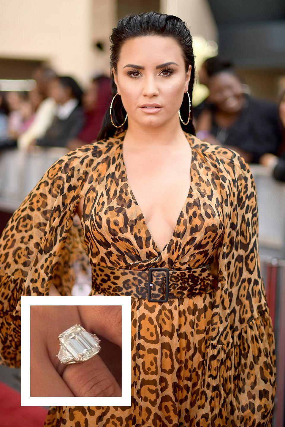 """<p>Just four months after actress and singer Demi Lovato made her relationship with Max Ehrich public, she <a href=""""https://www.instagram.com/p/CC-S49WhMDR/"""" rel=""""nofollow noopener"""" target=""""_blank"""" data-ylk=""""slk:took to Instagram to announce the news of her engagement"""" class=""""link rapid-noclick-resp"""">took to Instagram to announce the news of her engagement</a>. While the photos were adorable (Ehrich proposed on the beach), we couldn't help but notice her massive rock. Jewelry experts have weighed in, and the ring likely cost her fiancé anywhere from $500,000 to $1 million. </p>"""
