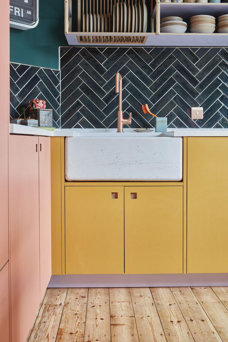 """<p>Why pick just one colour for your kitchen cupboards when you can have two, three or even four? This kitchen by Pluck combines pastel shades to joyful effect – even the kickboards have been given a lick of lilac. <a href=""""https://www.pluck.kitchen/"""" rel=""""nofollow noopener"""" target=""""_blank"""" data-ylk=""""slk:pluck.kitchen"""" class=""""link rapid-noclick-resp"""">pluck.kitchen</a></p>"""