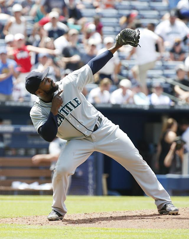 Seattle Mariners relief pitcher Fernando Rodney (56) reacts as he records the final out in the ninth inning of a baseball game against the Atlanta Braves Wednesday, June 4, 2014 in Atlanta. Seattle won 2-0 and Rodney earned a save. (AP Photo/John Bazemore)