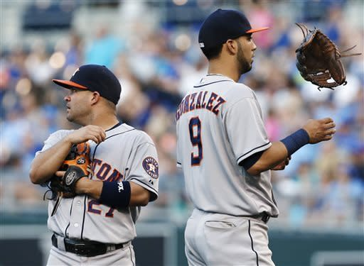Houston Astros second baseman Jose Altuve (27) and shortstop Marwin Gonzalez (9) wait during a pitching change during the fifth inning of a baseball game against the Kansas City Royals at Kauffman Stadium in Kansas City, Mo., Saturday, June 8, 2013. (AP Photo/Orlin Wagner)