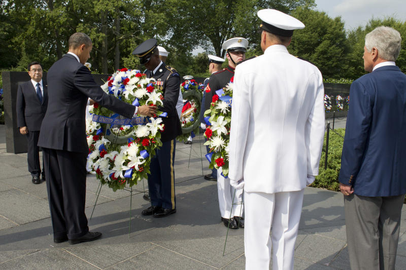President Barack Obama, left, participates in a wreath laying ceremony on the 60th anniversary of the end of the Korean War during at a commemorative ceremony at the Korean War Veterans Memorial on the National Mall in Washington, on Saturday, July 27, 2013. At far right is Defense Secretary Chuck Hagel. (AP Photo/Jacquelyn Martin)