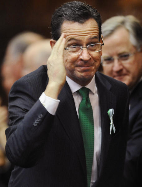 Connecticut Gov. Dannel P. Malloy, salutes as he arrives to speak to the House and the Senate in his State of the State address at the Capitol in Hartford, Conn., Wednesday, Jan. 9, 2013. Gun control, mental health care and school safety are expected to be major topics in the new session. Legislators also must grapple with a projected deficit of about $1.2 billion. (AP Photo/Jessica Hill)
