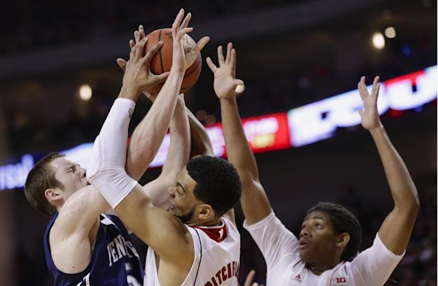 Penn State's Donovon Jack, left, Nebraska's Walter Pitchford, center, and David Rivers, right, struggle for a rebound in the first half of an NCAA college basketball game in Lincoln, Neb., Thursday, Feb. 20, 2014. (AP Photo/Nati Harnik)