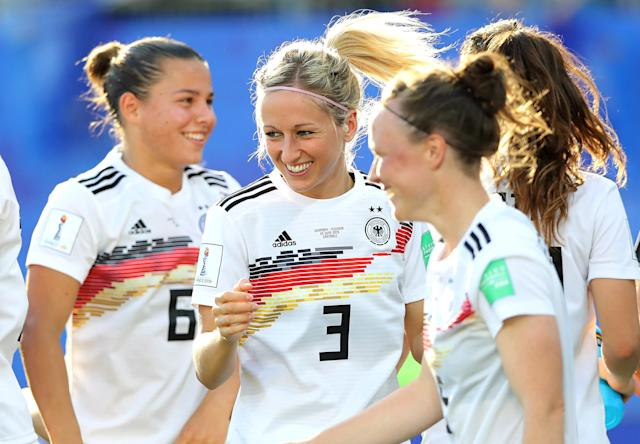 Kathrin Hendrich of Germany celebrates victory with her team mates after the 2019 FIFA Women's World Cup France Round Of 16 match between Germany and Nigeria at Stade des Alpes on June 22, 2019 in Grenoble, France. (Photo by Elsa/Getty Images)