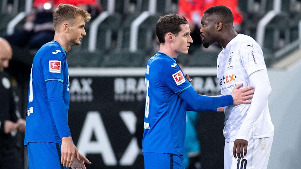 Seen here, Marcus Thuram and Stefan Posch clashing in the Bundesliga.