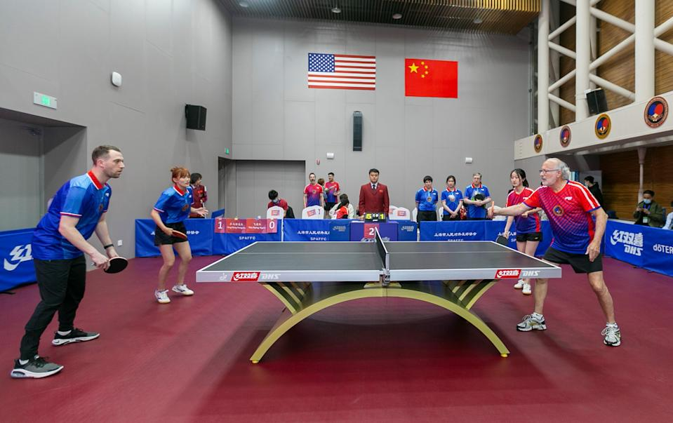 SHANGHAI, April 10, 2021 -- Players from both sides participate in a China-U.S. Ping-Pong friendly match during a special event in Shanghai, east China, April 10, 2021. A special event was held here on Saturday to commemorate the 50th anniversary of the Ping-Pong Diplomacy between China and the United States. (Photo by Wang Xiang/Xinhua via Getty) (Xinhua/Wang Xiang via Getty Images)