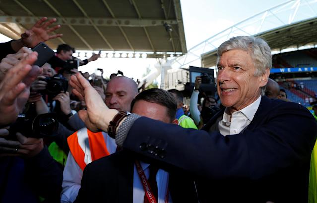 "Soccer Football - Premier League - Huddersfield Town vs Arsenal - John Smith's Stadium, Huddersfield, Britain - May 13, 2018 Arsenal manager Arsene Wenger acknowledges fans after the match Action Images via Reuters/Andrew Boyers EDITORIAL USE ONLY. No use with unauthorized audio, video, data, fixture lists, club/league logos or ""live"" services. Online in-match use limited to 75 images, no video emulation. No use in betting, games or single club/league/player publications. Please contact your account representative for further details."