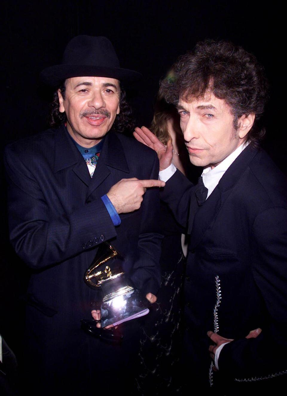 <p>Carlos Santana and Bob Dylan attend the Grammy Awards in Los Angeles on February 24, 2000.</p>
