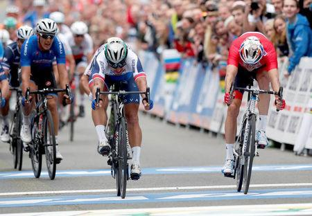 Cycling - UCI Road World Championships - Men Elite Road Race - Bergen, Norway - September 24, 2017 - Peter Sagan (C) of Slovakia finishes in first and Alexander Kristoff (R) of Norway in second place in Men Elite Road Race at the UCI 2017 Road World Championship, Bergen, Norway. NTB SCANPIX/Cornelius Poppe via REUTERS