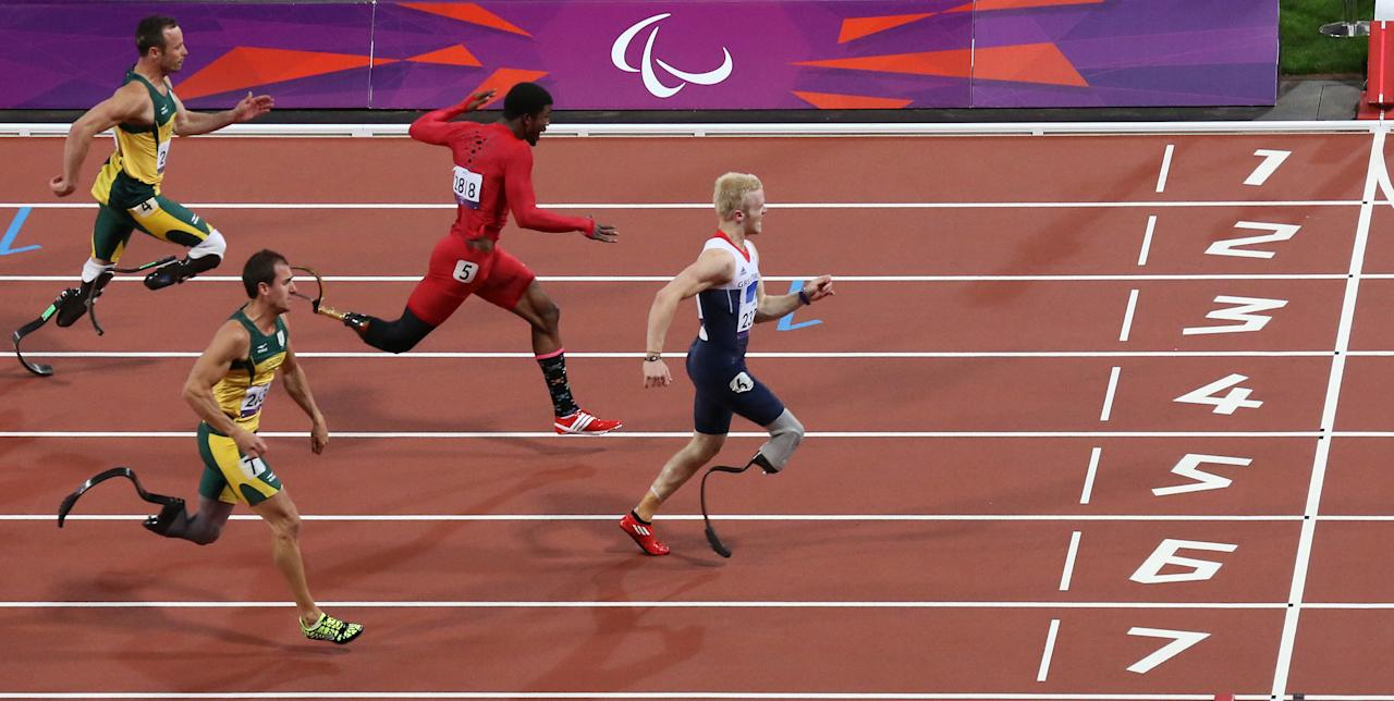 From left, Oscar Pistorius from South Africa, Arnu Fourie from South Africa, Richard Browne from the United States and Jonnie Peacock from Great Britain compete in the Men's 100 meter - T44 category final at the 2012 Paralympics games Thursday, Sept. 6, 2012, in London. Jonnie Peacock took the gold medal. (AP Photo/Raissa Ioussouf)