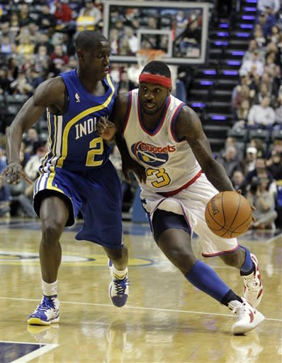 Denver Nuggets' Ty Lawson, right, drives to the basket against Indiana Pacers' Darren Collison during the first half of an NBA basketball game on Saturday, Feb. 11, 2012, in Indianapolis. (AP Photo/Darron Cummings)