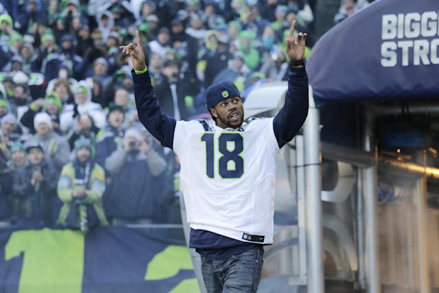 Seattle Seahawks' Sidney Rice walks on the field for a rally for the Super Bowl champions in Seattle on Wednesday, Feb. 5, 2014. (AP Photo/John Froschauer)