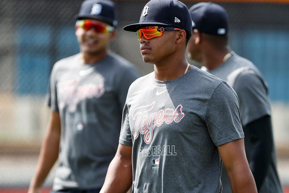 Infielder Wenceel Perez, center, warms up for practice during Detroit Tigers spring training at TigerTown in Lakeland, Fla., Thursday, Feb. 20, 2020.