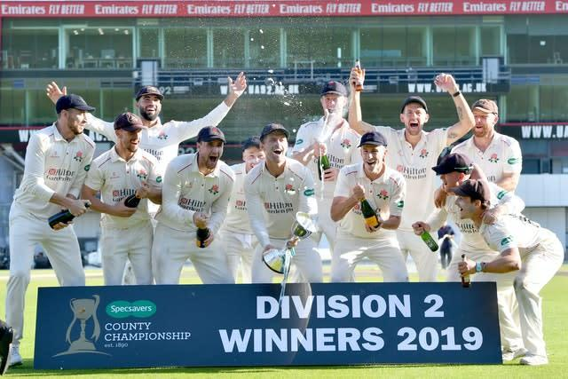 Vilas, centre, captained Lancashire to County Championship Division Two glory last year (Anthony Devlin/PA)
