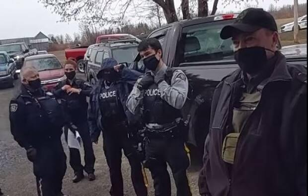 Officers with the RCMP and Department of Justice and Public Safety were filmed responding to the scene of an apparent illegal gathering.