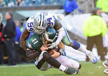 Jan 1, 2017; Philadelphia, PA, USA; Dallas Cowboys defensive end Randy Gregory (94) sacks Philadelphia Eagles quarterback Carson Wentz (11) during the third quarter at Lincoln Financial Field. The Eagles defeated the Cowboys, 27-13. Mandatory Credit: Eric Hartline-USA TODAY Sports