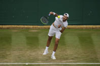 Russia's Karen Khachanov serves to Frances Tiafoe of the US during the men's singles third round match on day five of the Wimbledon Tennis Championships in London, Friday July 2, 2021. (AP Photo/Alastair Grant, Pool)