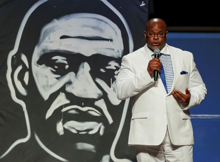 """Michael Tolds sings """"My Soul's Been Anchored"""" during the funeral for George Floyd on June 9, 2020, at The Fountain of Praise church in Houston (AFP Photo/Godofredo A. VASQUEZ)"""