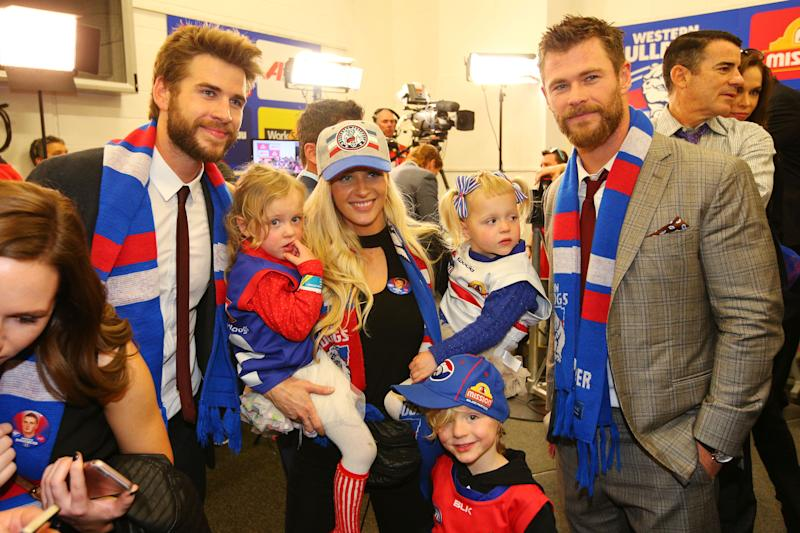 Actors Liam Hemsworth (L) and his brother Chris Hemsworth during the 2016 AFL Grand Final match between the Sydney Swans and the Western Bulldogs at Melbourne Cricket Ground on October 1, 2016 in Melbourne, Australia. (Photo by Michael Dodge/AFL Media/Getty Images)