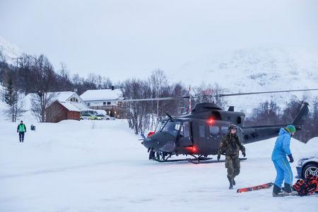 A military helicopter and rescue workers are seen in Tamokdalen, Norway, January 4, 2019. NTB Scanpix/Terje Bendiksby via REUTERS