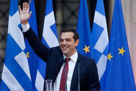 Greek Prime Minister Alexis Tsipras, wearing a tie, waves before a speech at the parliamentary group of Syriza and Independent Greeks in Athens, Greece June 22, 2018. REUTERS/Costas Baltas
