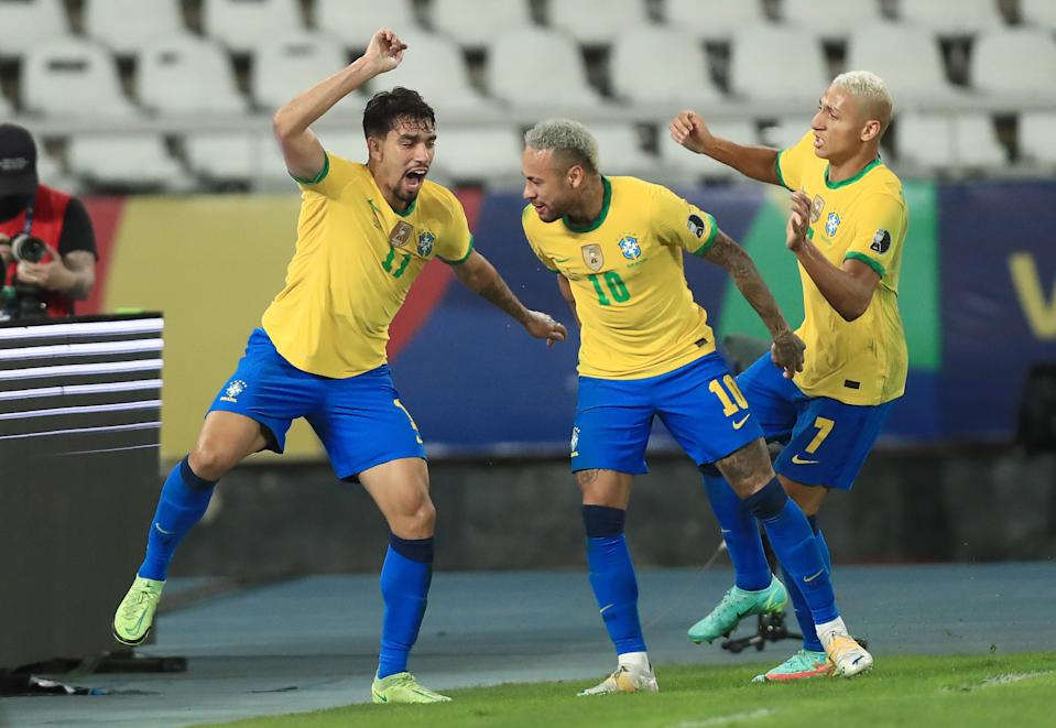 RIO DE JANEIRO, BRAZIL - JULY 05: (L-R) Lucas Paqueta of Brazil celebrates with teammates Neymar Jr. and Richarlison after scoring the first goal of his team during a semi-final match of Copa America Brazil 2021 between Brazil and Peru at Estadio Olímpico Nilton Santos on July 05, 2021 in Rio de Janeiro, Brazil. (Photo by Buda Mendes/Getty Images)