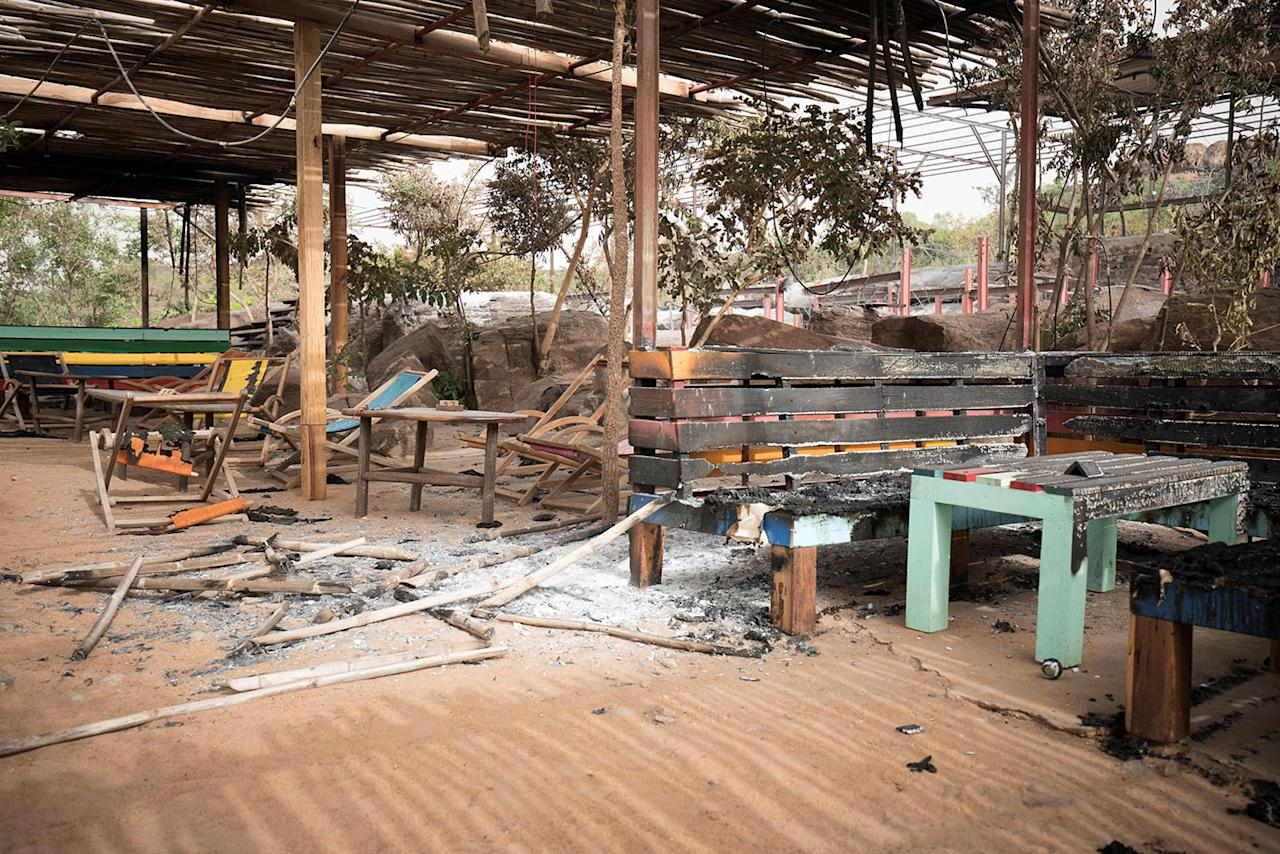 <p>A picture taken on June 19, 2017 in Kangaba tourist resort near Bamako shows the smoldering remains after suspected jihadists stormed the resort on June 18, briefly seizing more than 30 hostages and leaving at least two people dead. (Michele Cattani/AFP/Getty Images) </p>