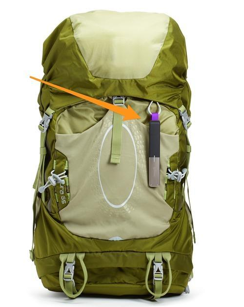 A goTenna clipped to a backpack