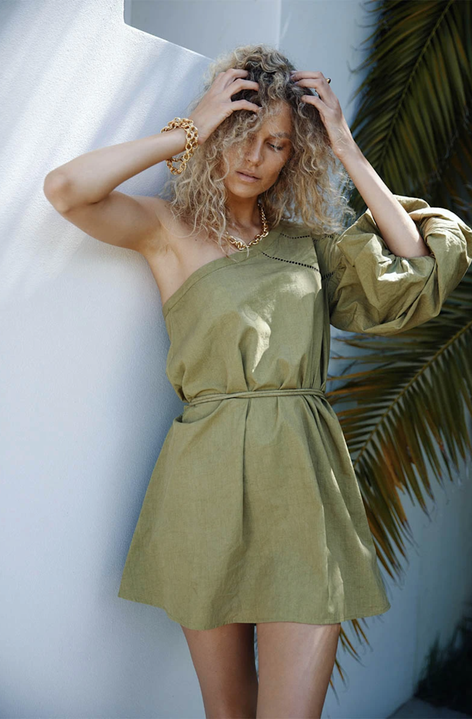 """This slouchy linen dress is begging to be worn to a beach wedding. Psst…need more summer wedding dress inspo? We've got plenty <a href=""""https://www.glamour.com/gallery/summer-wedding-guest-dresses?mbid=synd_yahoo_rss"""" rel=""""nofollow noopener"""" target=""""_blank"""" data-ylk=""""slk:here"""" class=""""link rapid-noclick-resp"""">here</a>. $142, Maurie & Eve. <a href=""""https://www.maurieandeve.com/collections/beach-dresses/products/poplin-mini-dress-ol"""" rel=""""nofollow noopener"""" target=""""_blank"""" data-ylk=""""slk:Get it now!"""" class=""""link rapid-noclick-resp"""">Get it now!</a>"""