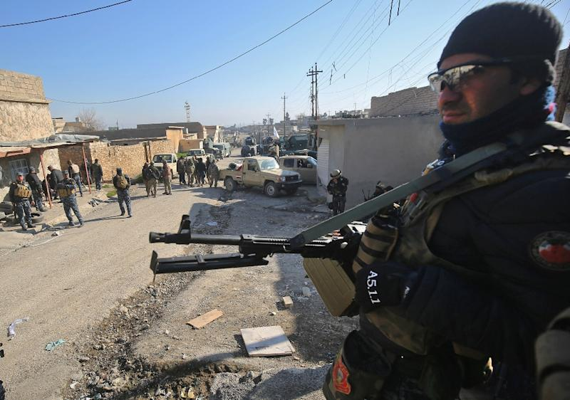 Iraqi forces are deployed in the village of al-Buseif, south of Mosul, during an offensive to retake the western side of the city from Islamic State (IS) group fighters on February 21, 2017