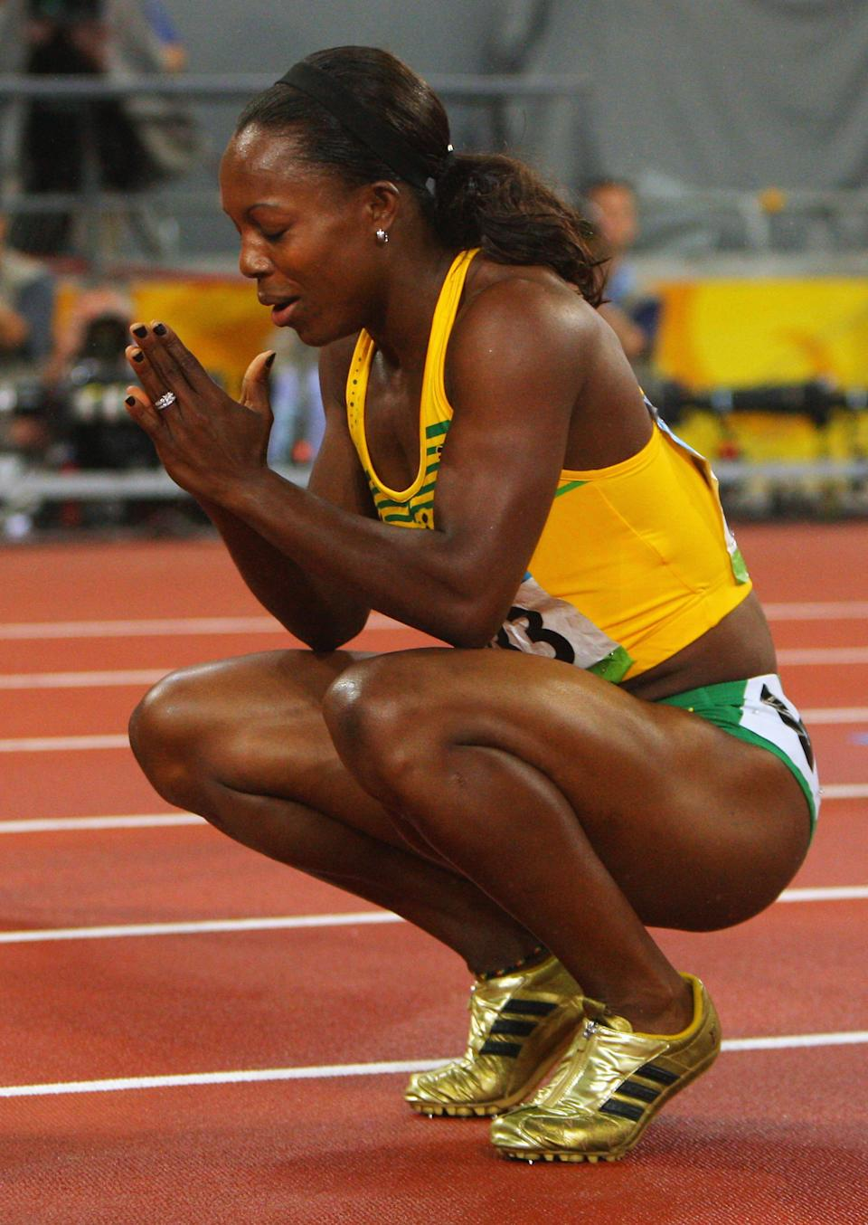 BEIJING - AUGUST 21: Veronica Campbell-Brown of Jamaica celebrates winning the Women's 200m Final and the gold medal held at the National Stadium during Day 13 of the Beijing 2008 Olympic Games on August 21, 2008 in Beijing, China. (Photo by Stu Forster/Getty Images)