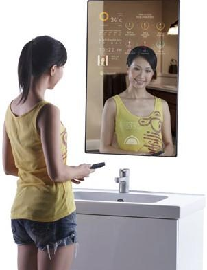 Woman looking into touchscreen mirror