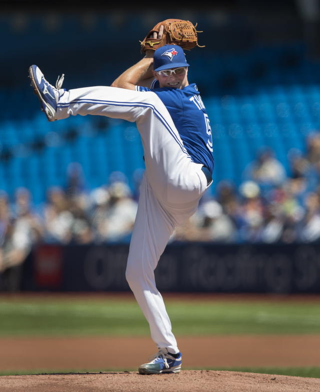 Toronto Blue Jays starting pitcher Trent Thornton throws against the New York Yankees during the first inning of a baseball game in Toronto, Sunday, Aug. 11, 2019. (Fred Thornhill/The Canadian Press via AP)