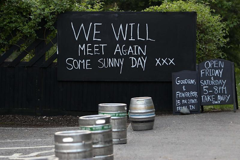 A chalk board is seen at a local pub in Burridge, which offers take-away beer for members of the public: Getty Images