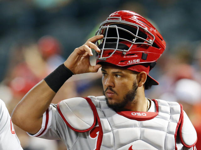 FILE - In this Monday, Aug. 6, 2018 file photo, Philadelphia Phillies catcher Jorge Alfaro (38) watches in the first inning during a baseball game against the Arizona Diamondbacks in Phoenix. During the offseason the Miami Marlins announced new concession offerings that included mushroom tacos, fries with mole sauce and bottomless popcorn and soda. The woebegone franchises biggest offseason move came Thursday, when the Marlins traded All-Star catcher J.T. Realmuto to the Philadelphia Phillies for catcher Jorge Alfaro, two pitching prospects and $250,000 in international signing bonus pool allocation. (AP Photo/Rick Scuteri, File)