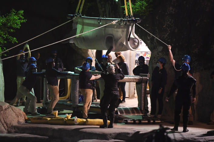 A Beluga whale is transported at Mystic Aquarium after arriving from Canada, Friday, May 14, 2021 in Mystic, Conn. A total of five Beluga whales from Marineland in Niagara Falls, Ontario, Canada will be moved to the aquarium. The whales will be leaving an overcrowded habitat with about 50 other whales and will be at the center of important research designed to benefit Belugas in the wild. (AP Photo/Jessica Hill)