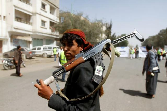 FILE PHOTO: A Houthi supporter looks on as he carries a weapon during a gathering in Sanaa