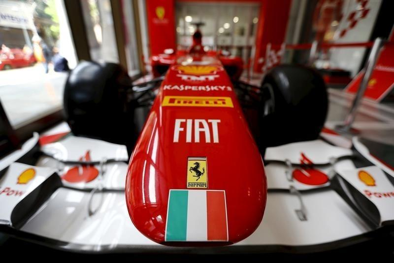 Ferrari and Fiat logos and a Italian flag are pictured on a replica of a Ferrari Formula One car in Santiago