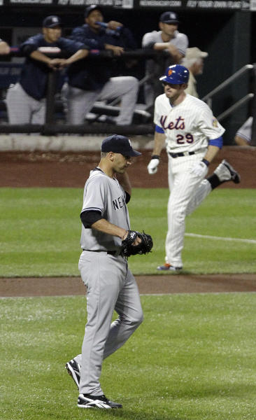 New York Yankees starting pitcher Andy Pettitte, bottom, looks on as New York Mets' Ike Davis (29) heads to home plate after hitting a three-run home run during the first inning of an interleague baseball game on Friday, June 22, 2012, in New York. (AP Photo/Frank Franklin II)