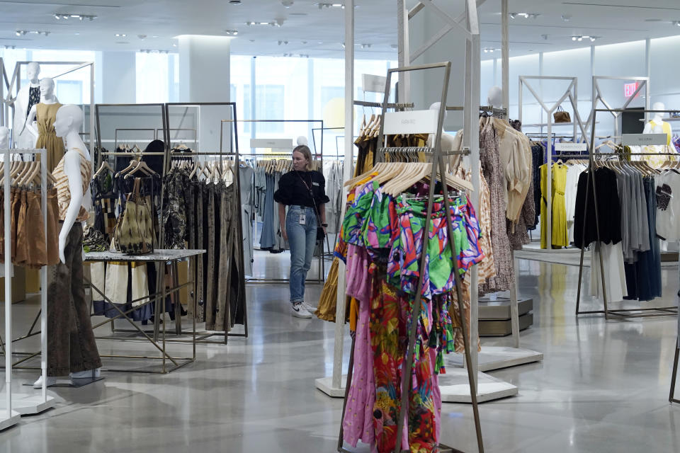 A woman shopper browses merchandise at the Nordstrom NYC Flagship store, in New York, Wednesday, July 14, 2021. Like many of its peers, venerable department store chain Nordstrom is having a tough time keeping pace with customer demand for new clothes because of supply issues. (AP Photo/Richard Drew)