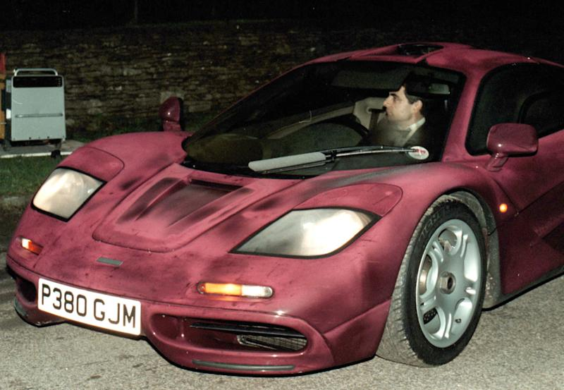 Photo dated Nov. 15 1998 of comedian Rowan Atkinson at the wheel of his McLaren F1 sports car. It was reported Friday Feb. 8 2013 that it took more than a year — and more than 900,000 pounds ($1,400,000) — to get his supercar up and running after a 2011 crash in which he badly injured a shoulder,  but F1's now sell for around 3.5 million pounds. The car makes extensive use of carbon fiber and needed specialist care. The car insurance settlement is one of the largest in British history. (AP Photo/Barry Batchelor/PA)  UNITED KINGDOM OUT  NO SALES  NO ARCHIVE