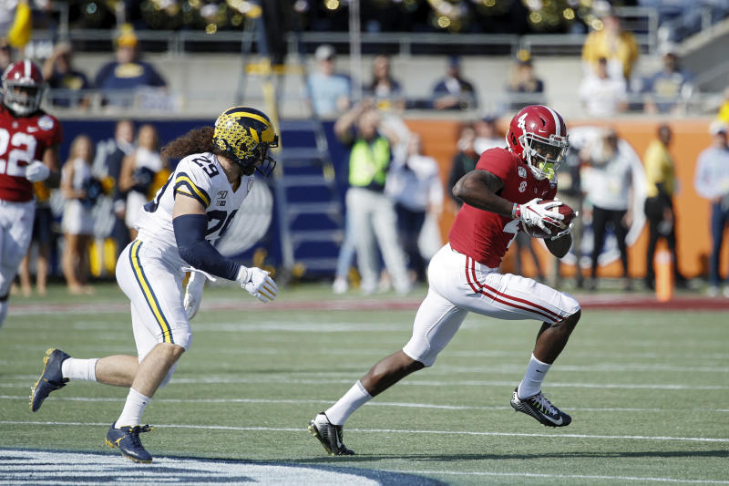 ORLANDO, FL - JANUARY 01: Jerry Jeudy #4 of the Alabama Crimson Tide runs after catching a pass against Jordan Glasgow #29 of the Michigan Wolverines in the first quarter of the Vrbo Citrus Bowl at Camping World Stadium on January 1, 2020 in Orlando, Florida. (Photo by Joe Robbins/Getty Images)