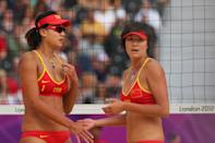 LONDON, ENGLAND - JULY 28: Chen Xue (L) and Xi Zhang of China look on during Women's Beach Volleyball match between China and Russia on Day 1 of the London 2012 Olympic Games at Horse Guards Parade on July 28, 2012 in London, England. (Photo by Alexander Hassenstein/Getty Images)