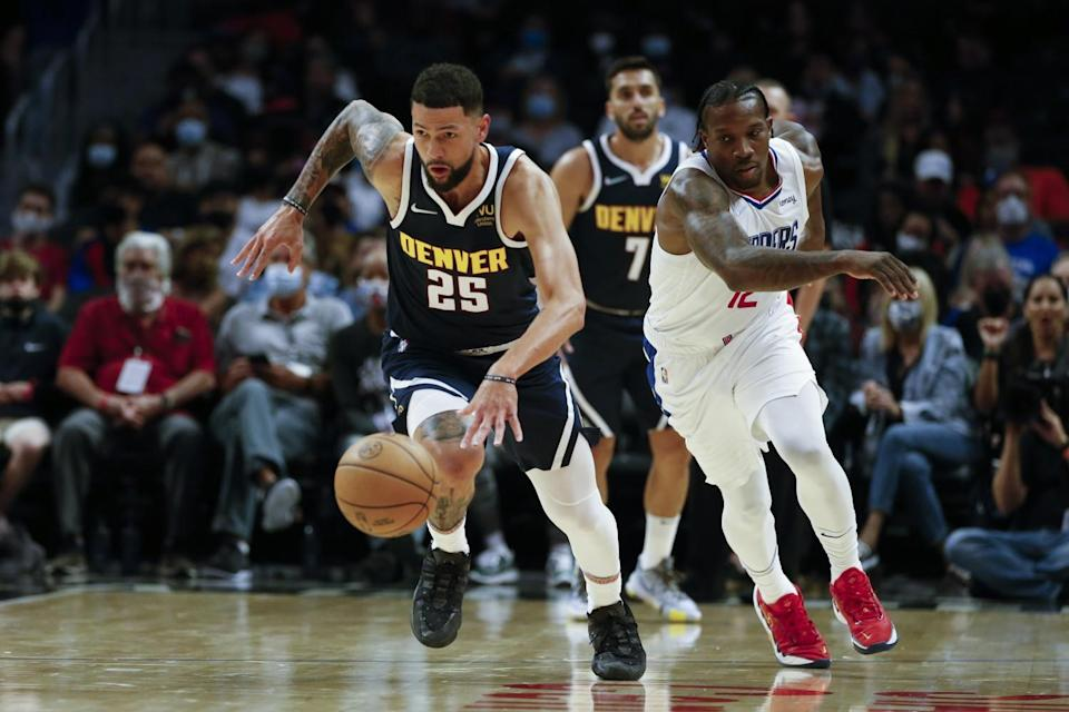Denver Nuggets guard Austin Rivers drives the ball away from Clippers guard Eric Bledsoe.