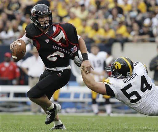 Iowa defensive line Steve Bigach (54) tackles Northern Illinois quarterback Jordan Lynch (6) as he looks to a pass during the first half of an NCAA college football game at Soldier Field in Chicago, Saturday, Sept. 1, 2012. (AP Photo/Nam Y. Huh)