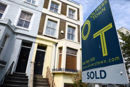 An estate agent board is displayed outside a property in London, Britain July 7, 2017. REUTERS/Neil Hall