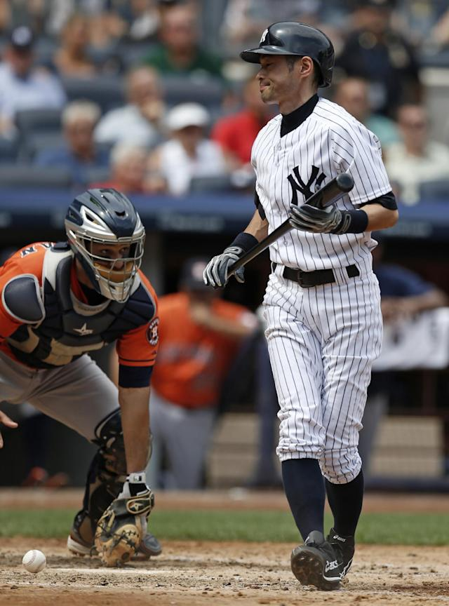 New York Yankees' Ichiro Suzuki reacts after striking out in the fifth inning of a baseball game against the Houston Astros at Yankee Stadium in New York, Thursday, Aug. 21, 2014. (AP Photo/Kathy Willens)