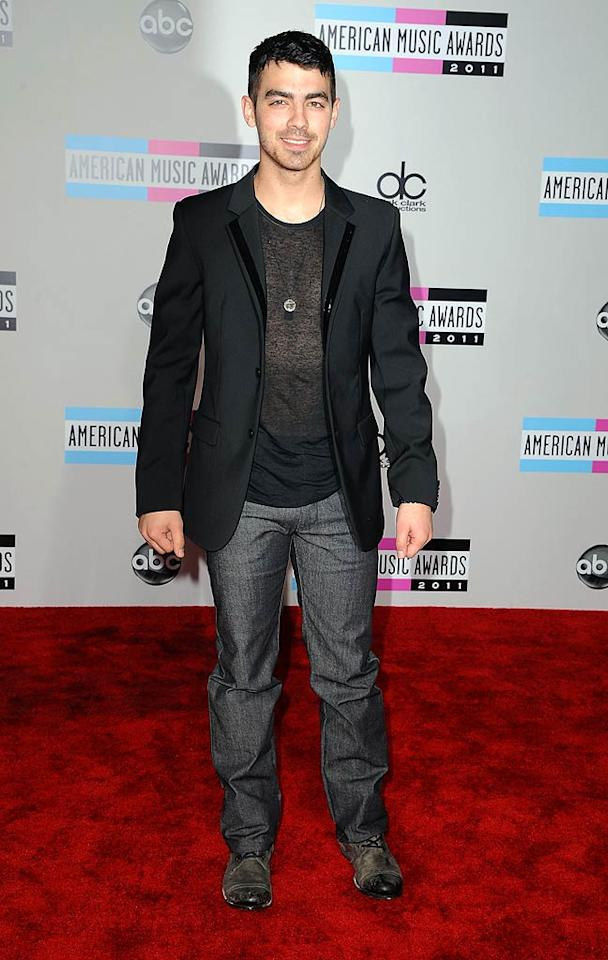 Joe Jonas arrives at the 2011 American Music Awards held at the Nokia Theatre L.A. LIVE. (11/20/2011)
