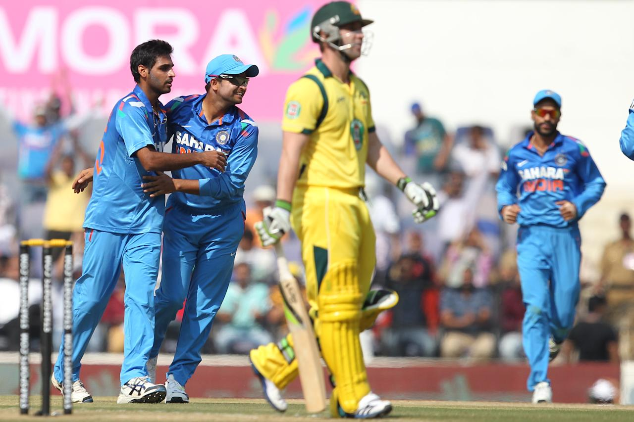 Bhuvneshwar Kumar celebrates wicket of Phillip Hughes during the sixth Star Sports Series One Day International (ODI) between India and Australia held at the VIDARBHA CRICKET ASSOCIATION STADIUM, NAGPUR on the 30th October 2013